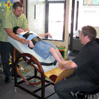 Dr. Fred Clary and Intern Matt work with Max Cerebral Palsy MN